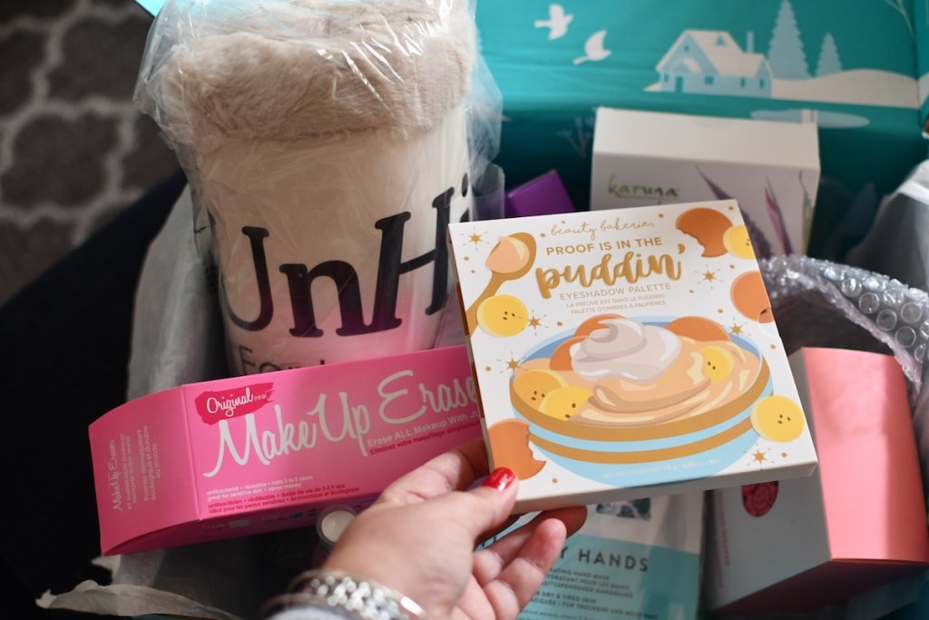 hand holding Proof is in the Puddin Palette by Fab Fit Fun Box