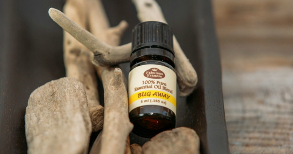 bottle of Fabulous Frannie Bug Away Essential Oil on rock