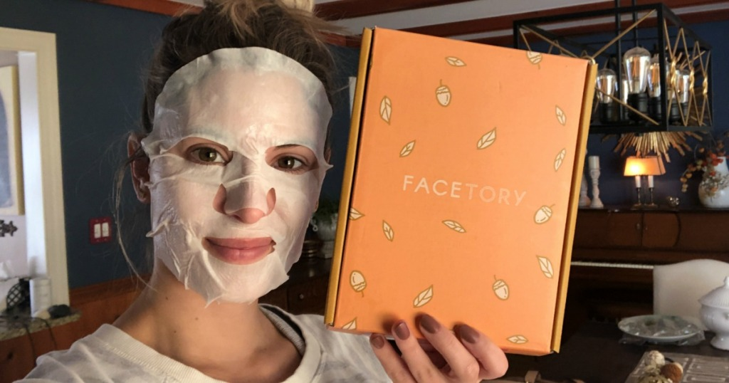 Woman wearing Facetory Mask and holding box