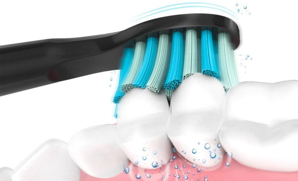 black electric toothbrush brushing teeth