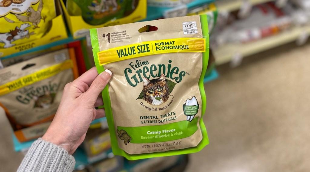 hand holding Feline Greenies at Petsmart