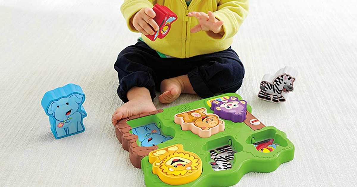 boy playing with Fisher-Price Animal Puzzle