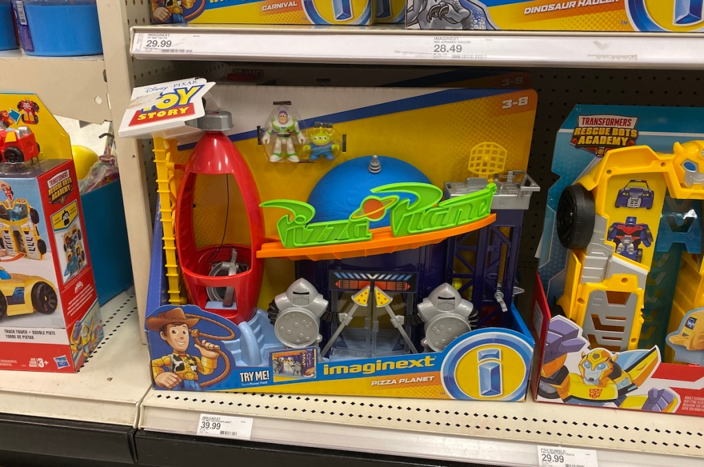 Fisher-Price Imaginext Disney Pixar Toy Story 4 Pizza Planet Playset on shelf at Target