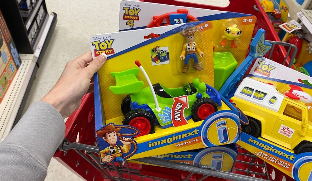 hand holding Fisher-Price Imaginext Disney Pixar Toy Story 4 Woody And R:C