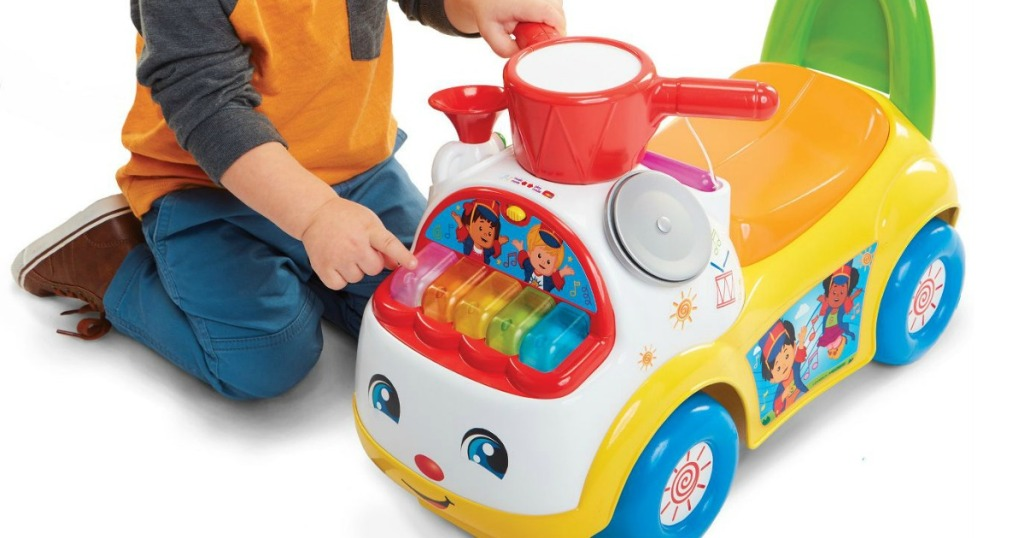 kid playing with Fisher-Price Parade Ride On