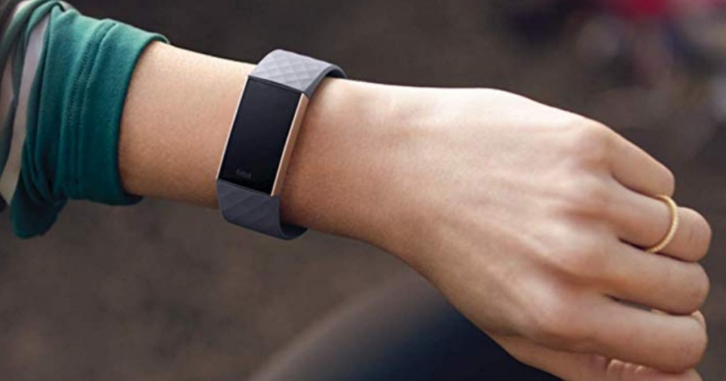 Woman wearing Fitbit Charge 3 Activity Tracker in gray