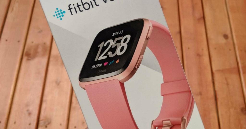 hand holding Fitbit Versa box