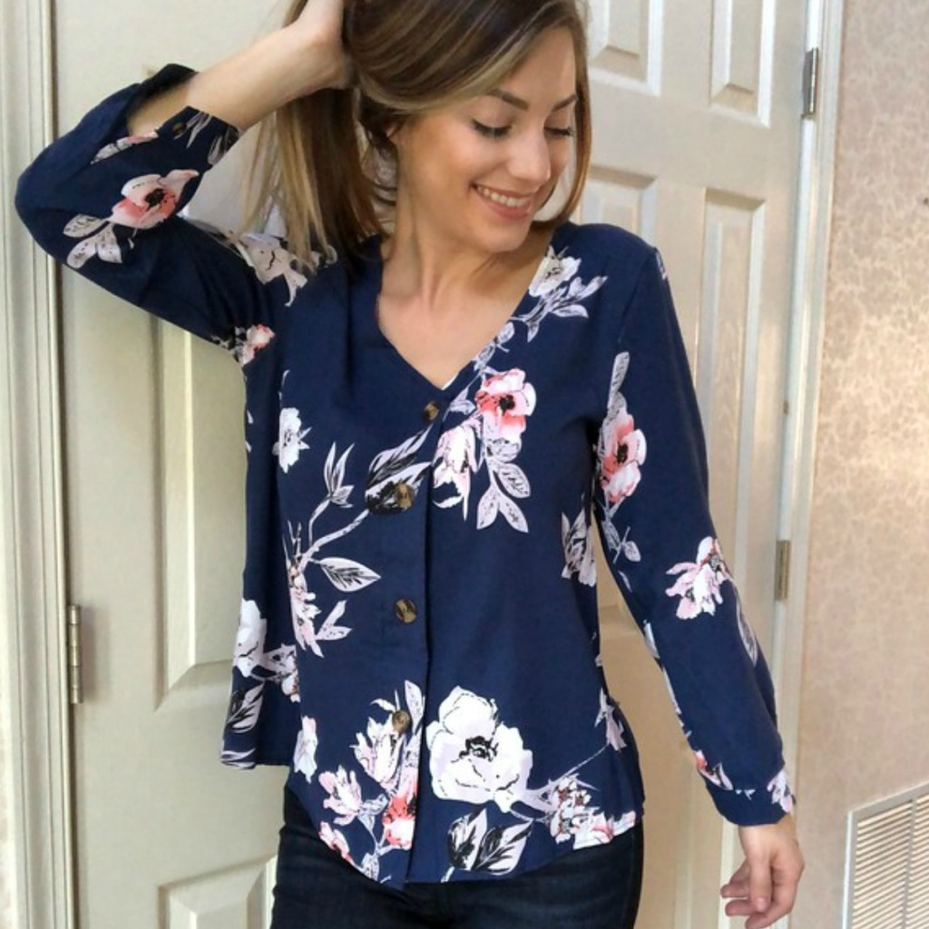 girl wearing a navy blue and floral shirt
