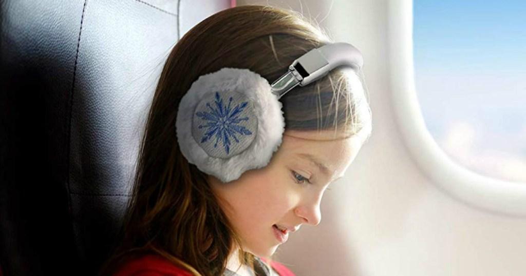 Girl wearing Frozen headphones
