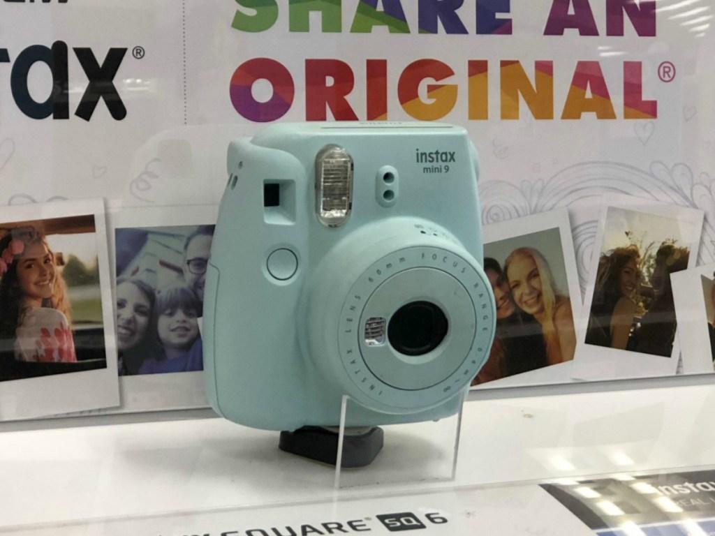 Instax Mini 9 camera on display in-store