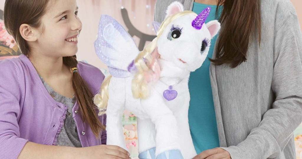 Daughter and mom playing with a FurReal unicorn plush