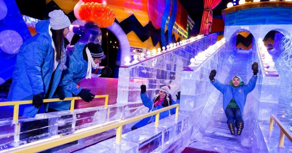 Kids sledding inside Gaylord Palms