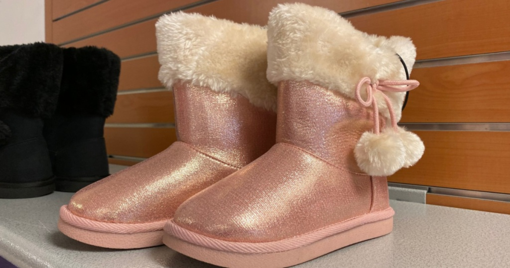 girls pink boots on shelf at jcpenney
