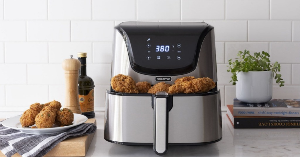 Gourmia 6-qt. Stainless Steel full of fried chicken on counter