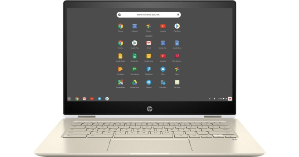 laptop with home screen on and gold keyboard