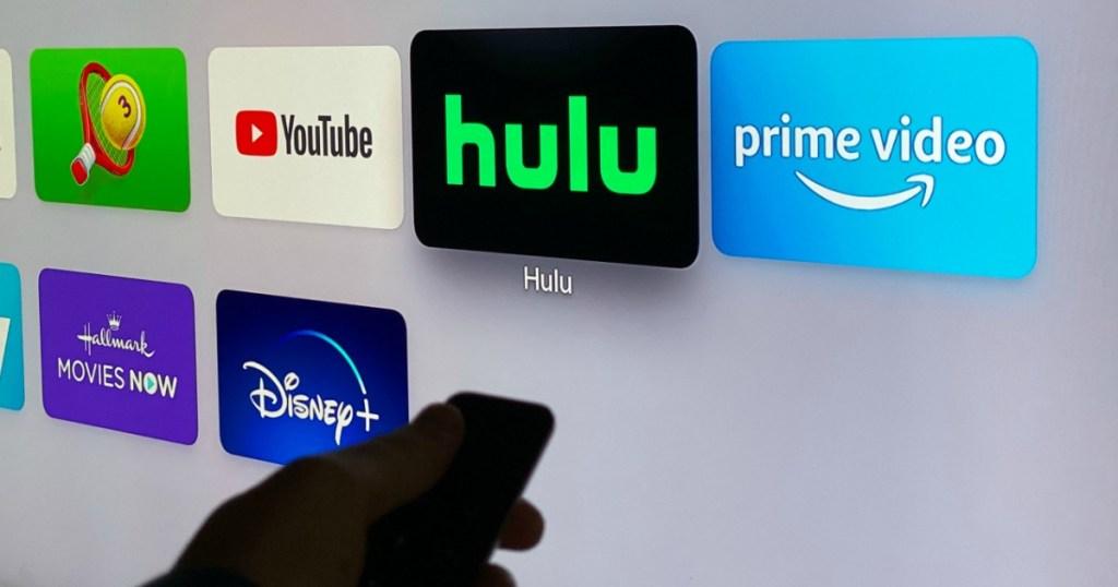 man choosing Hulu on his TV