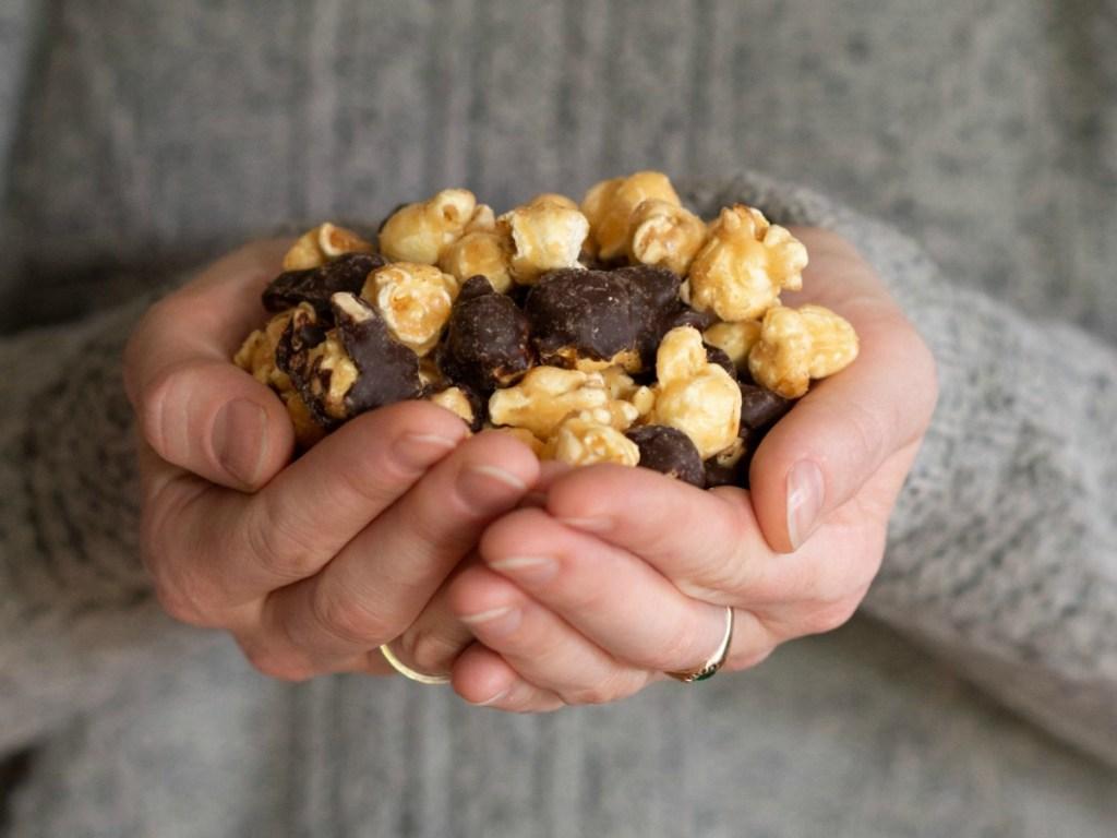 Woman holding a handful of premium popcorn