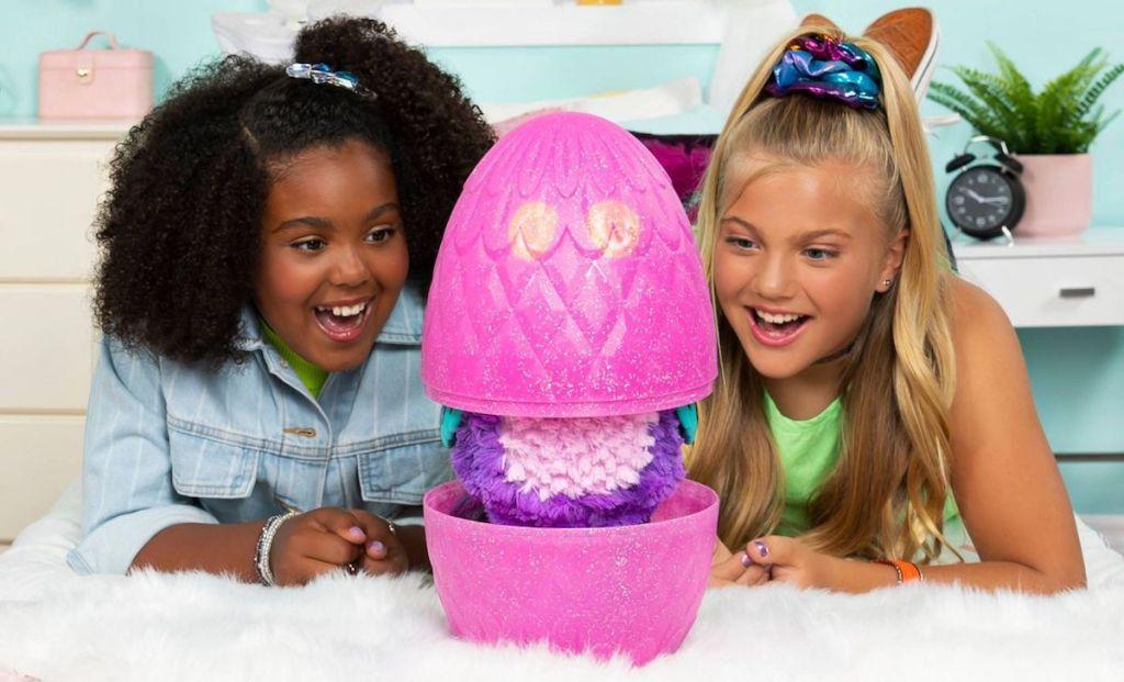 girls watching Hatchimals egg hatch