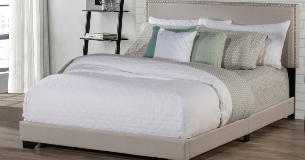 tan bed and headboard with white and tan bedding