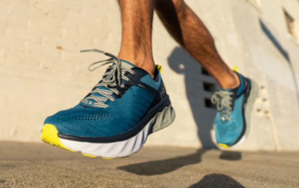 Man wearing Hoka One Men's Running Shoes