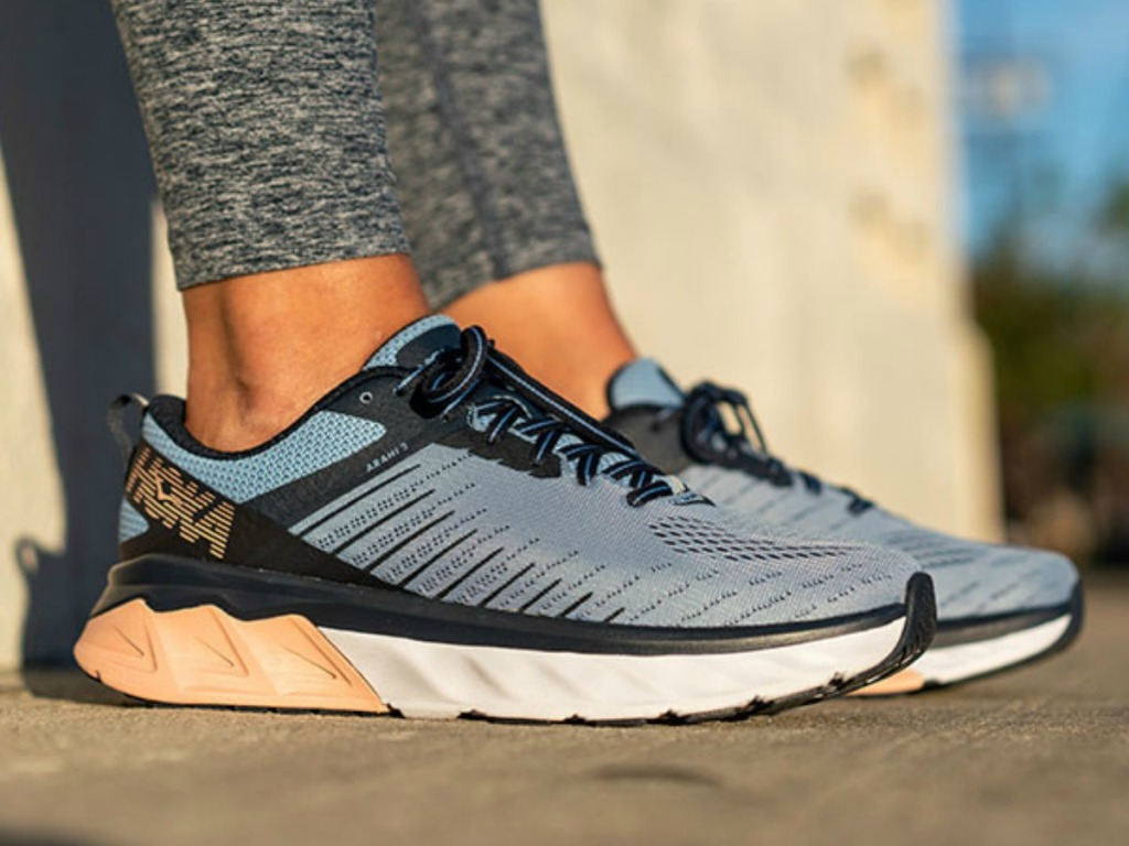 Woman wearing Hoka brand women's running shoes
