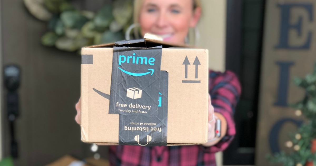 woman holding out Amazon Prime Box