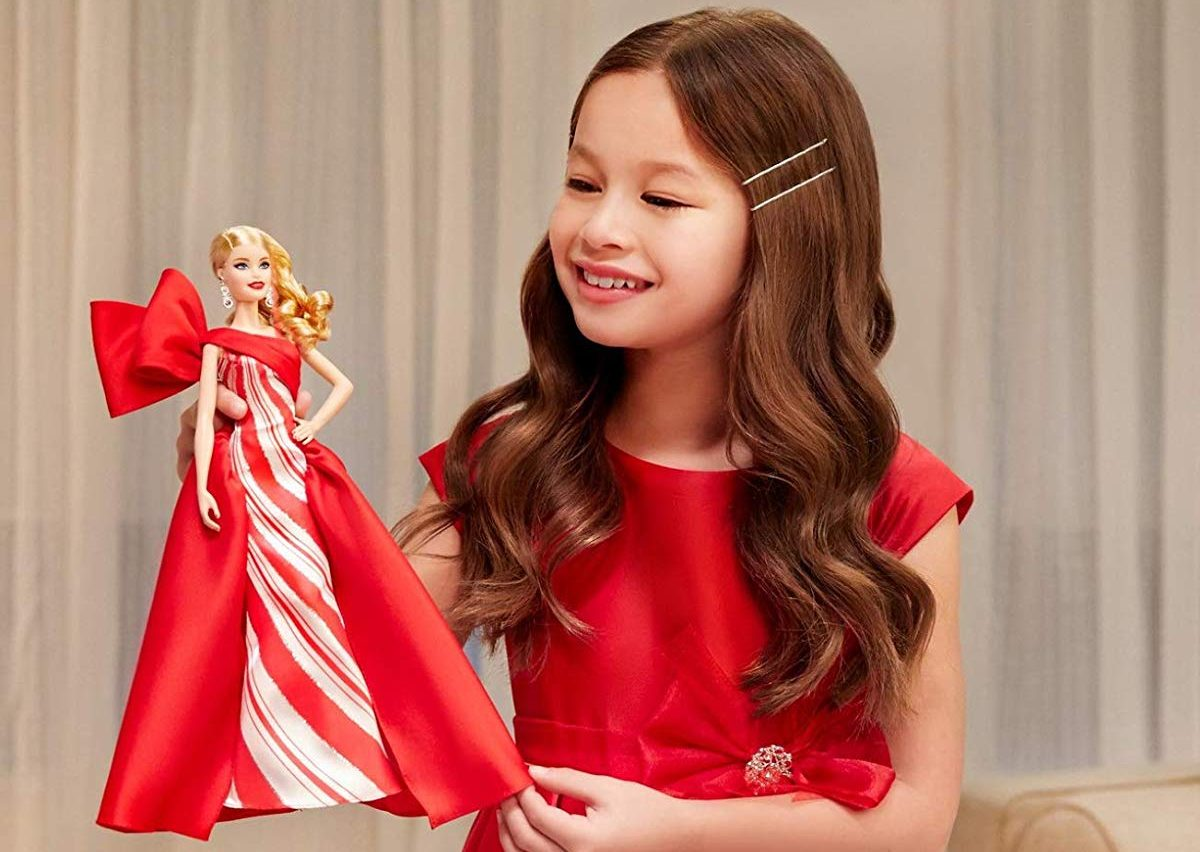 girl holding Holiday Barbie 2019
