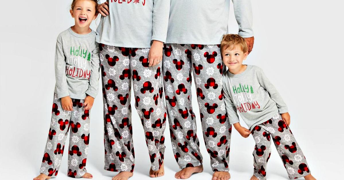 family wearing holiday Mickey Mouse fleece pajama pants