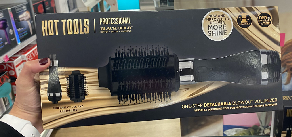hand holding a volumizer hair tool in box in store