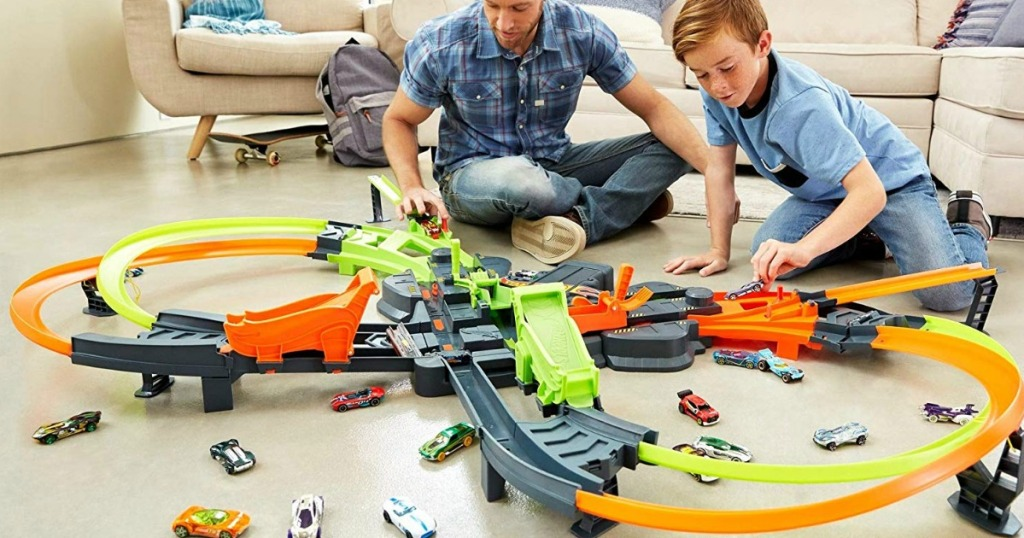 people playing with the Hot Wheels Colossal Crash set