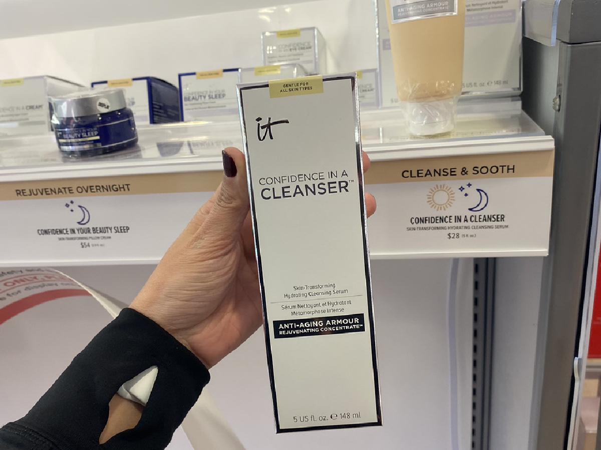 hand holding facial cleanser in store