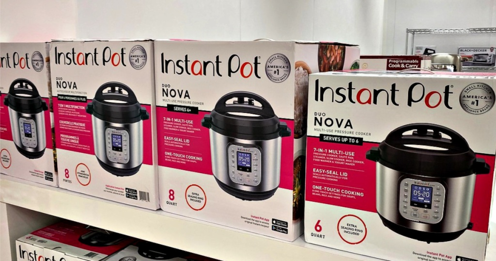Instant Pot Duo Nova pressure cookers in boxes on a store shelf