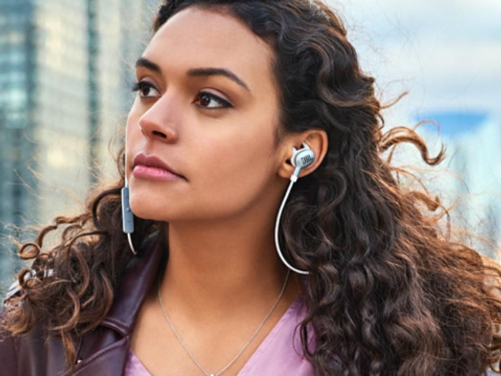 Woman in the city wearing JBL Earbuds