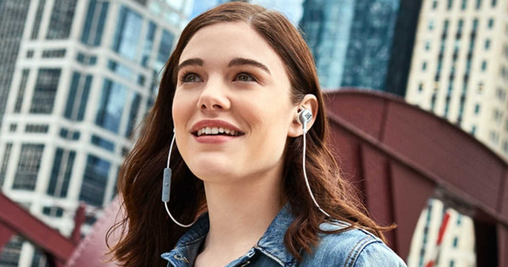 Young woman wearing JBL Earbuds