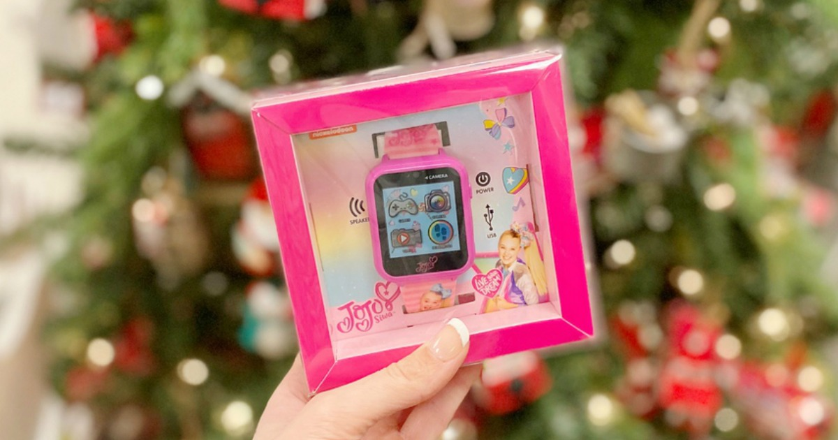 JoJo Siwa Watch near Christmas tree