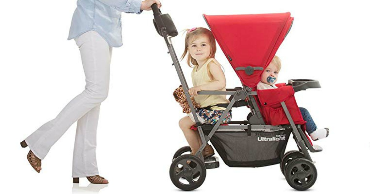 woman pushing red stroller with kids