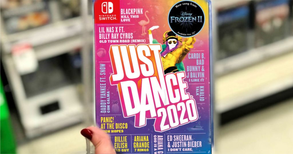 hand holding a Just Dance 2020 Nintendo Switch video game