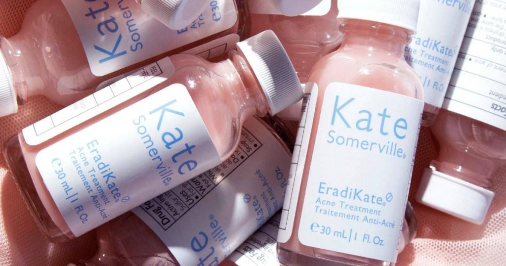 A pile of bottles of Kate Somerville EradiKate