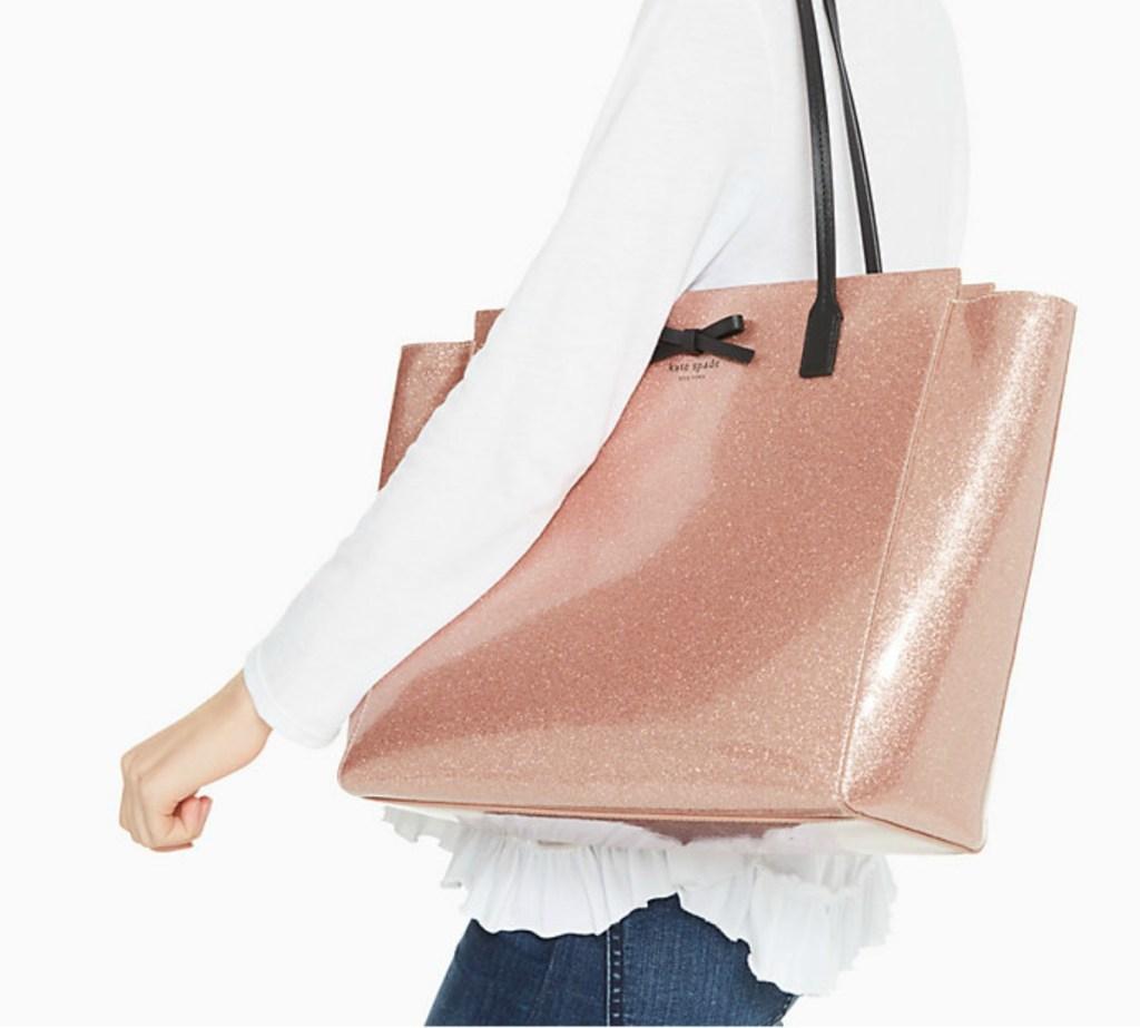 woman carrying Kate Spade Taden bag