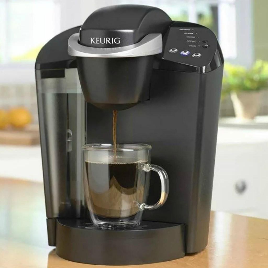 Keurig Coffee maker in black on counter top in kitchen