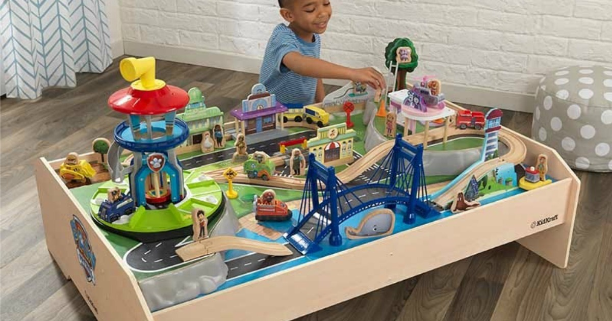 boy playing with KidKraft Paw Patrol Train Table