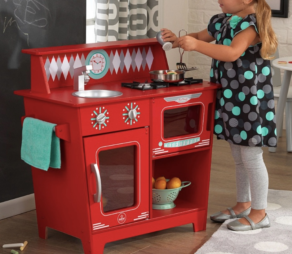 toddler girl playing with KidKraft Red Classic Kitchenette