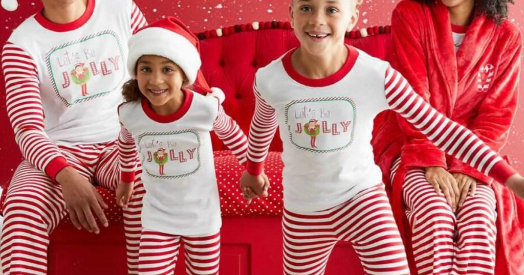 Family wearing coordinating elf pajamas