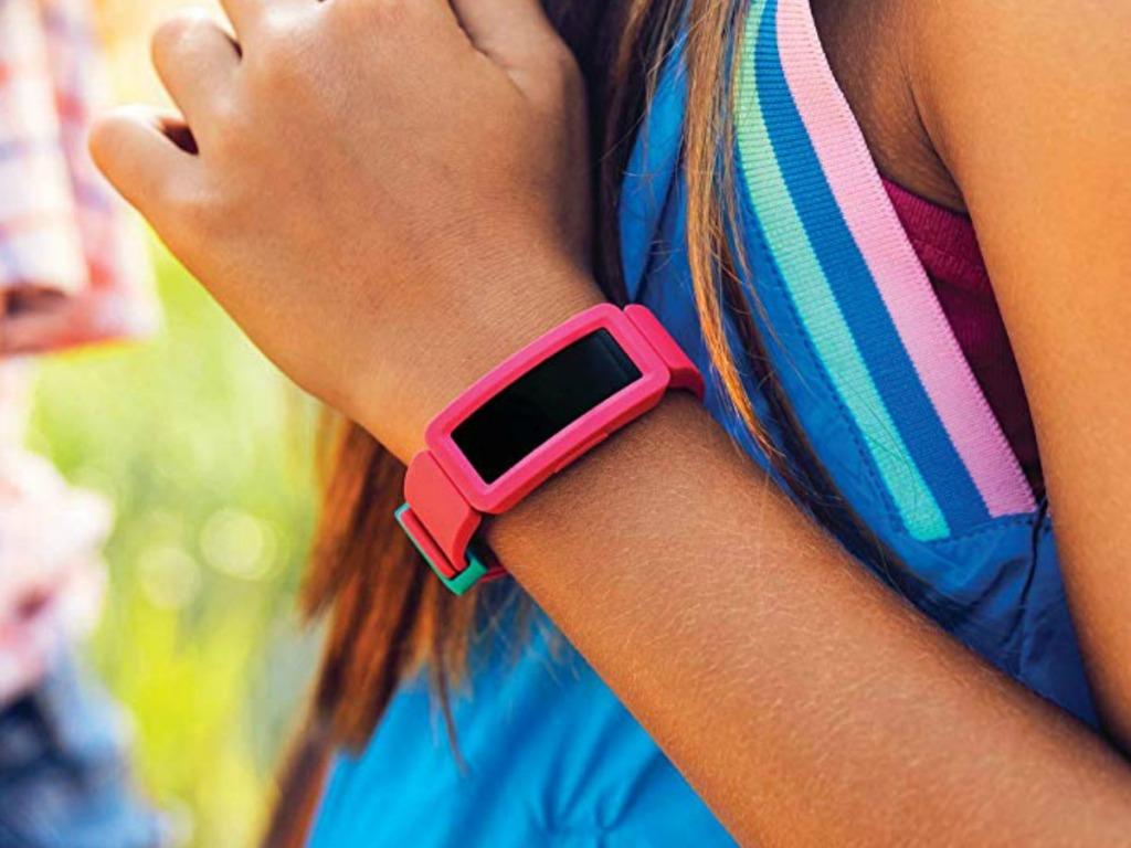 Girls wearing a Kids FitBit Ace Activity Tracker