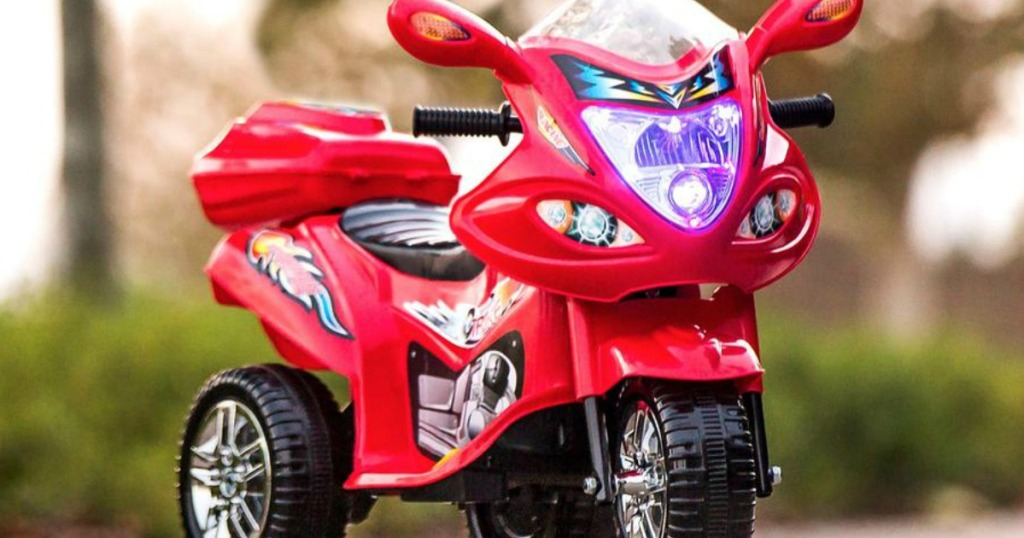 Kids Ride On Motorcycle in red outside