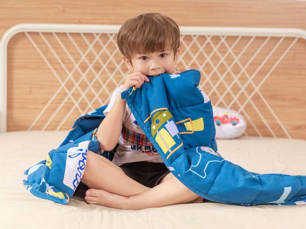 boy with blue weighted blanket