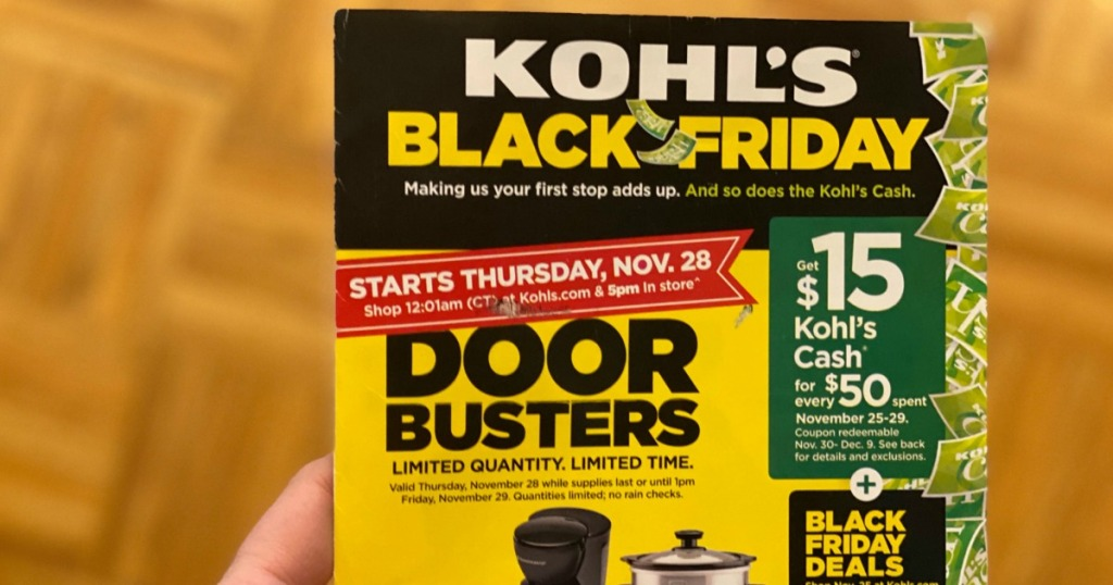 woman holding Kohl's Black Friday flyer