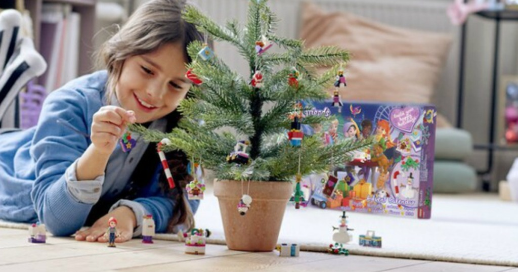 Girl playing with a LEGO Friends Advent Calendar