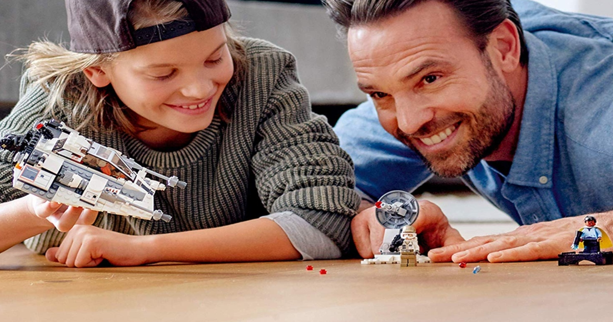 LEGO Star Wars Snow Speeder, Father and son playing with set on a wood floor