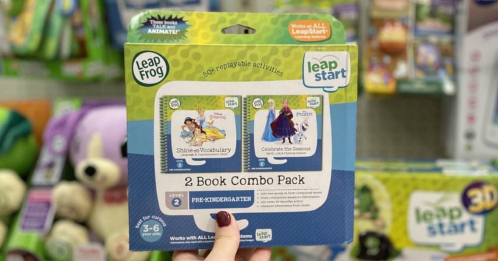 hand holding LeapFrog LeapStart books